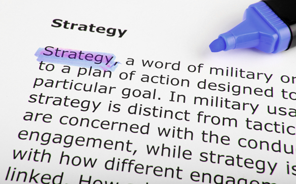 highlighter pen highlighting the word strategy